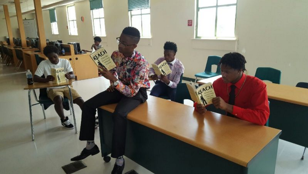 A group of students all reading the same book